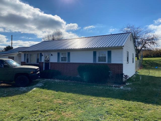 Newer metal roof and fenced in back yard. Home has large living room and a large family room with wood a burning fireplace. There is a room perfect for a home office which has it's own outside access. Large covered back porch and a open side deck. Large unfinished basement. New owner should verify internet access.