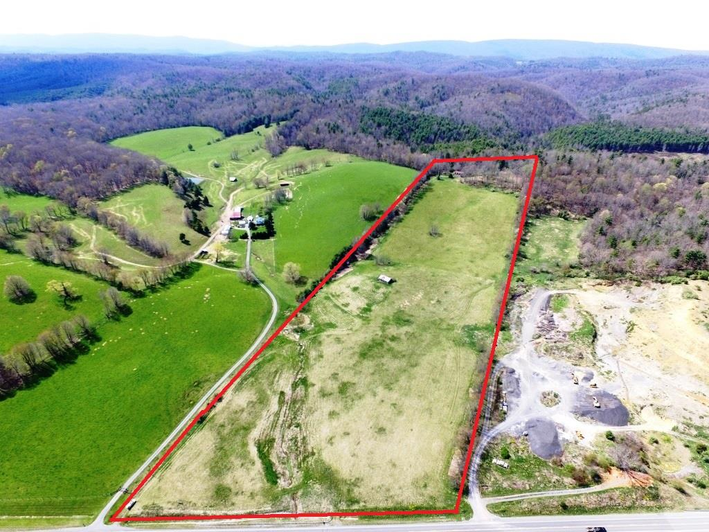 MAGNIFICENT VIEWS ON 27 ACRES IN PICTURESQUE BLAND CO.; 5 BR, 3.5 BA MOUNTAINTOP HOME OVERLOOKING S. SCENIC HIGHWAY, I-77 AND ALL THE ACTIVITY OFF EXIT 52; ENDLESS POSSIBILITIES!  SOME PAINT AND A FEW HOURS OF WORK WILL RESTORE THIS ONCE BEAUTIFUL HOME TO IT'S FORMER SPARKLE.