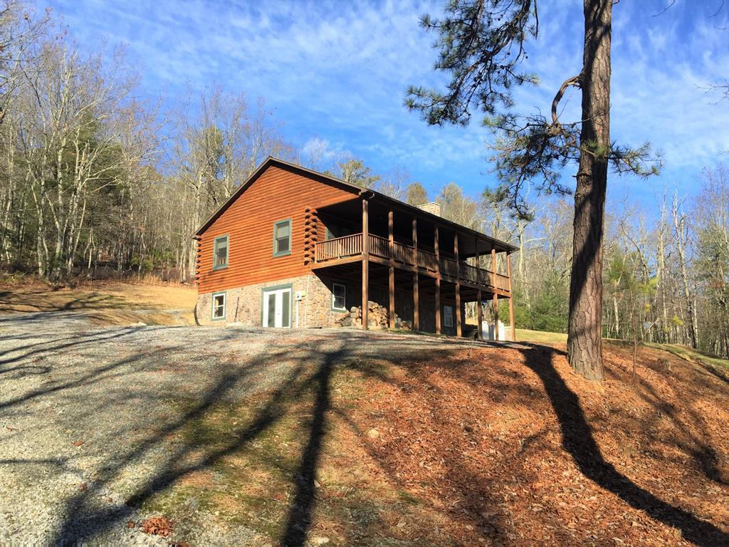 ENJOY UNBELIEVEABLE PEACE AND QUIET IN THIS  SECTION OF WYTHE CO.  CUSTOM BUILT LOG  HOME SECLUDED AND COMPLETELY SURROUNDED BY FOREST...SIT ON YOUR LARGE COVERED PORCH AND WATCH THE WILDLIFE PLAY IN YOUR OWN YARD.  A HUNTER'S DREAM, PERMANENT HOME OR FANTASTIC SECOND HOME GET-AWAY.  LONG WELL-MAINTAINED DRIVE TO THE HOUSE FROM CROCKETT'S COVE ROAD;  YOUR COUNTRY ESCAPE CONSISTS OF VAULTED CEILINGS, CUSTOM LOGS, HARDWOOD FLOORS, FLUE, OPEN FLOOR PLAN,HEAT PUMP, NEAR NATIONAL FOREST, CUSTOM WOOD DOORS, STUDDED BASEMENT READY FOR YOUR CREATIVITY...POSSIBLE BEDROOM, FAMILY ROOM, LAUNDRY, BATH AND STORAGE ALONG WITH COVERED PATIO OVERLOOKING BEAUTIFUL COVE COMMUNITY.  THERE IS A WATER SYSTEM AND A BASEMENT HEAT SYSTEM IN PLACE. THE ADJOINING PROPERTY WHICH JOINS THE NATIONAL FOREST MAY ALSO BE BOUGHT.