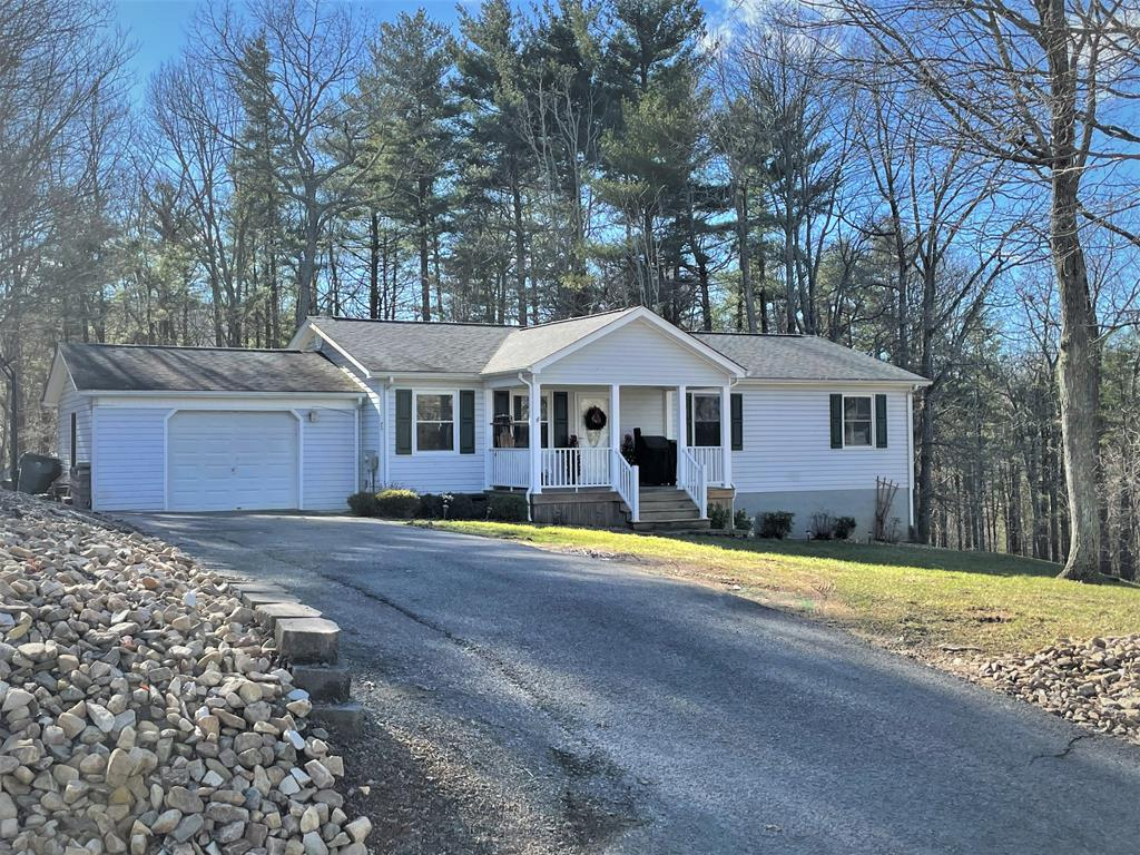 Affordable and just outside of Hillsville town limits! This 3BD, 2BA home offers 1,657 SF with a full walk out basement. Updates to the home are a master bath of tile and granite, tile floors in the kitchen and 2nd bath, laminate floors in the living room and bedrooms, newer stainless steel kitchen appliances, and a beaded-board, panel den in the basement. Windows are Pella insulated replacements. Paint is fresh and modern as is the bright laundry room located just off the den downstairs. Directly off the dining room through double French doors is a very nice sunroom looking out to the fenced back yard and mature trees. Propane is already installed if you choose to add another heat source. The Oak Knoll community is just minutes to town but there are no town taxes, no HOA fees, and no water bills as you have your own septic and deep cold water well. Just the right distance to everything. This home is served by Xfinity high speed internet and TV. Weekly trash pickup available by GFL.