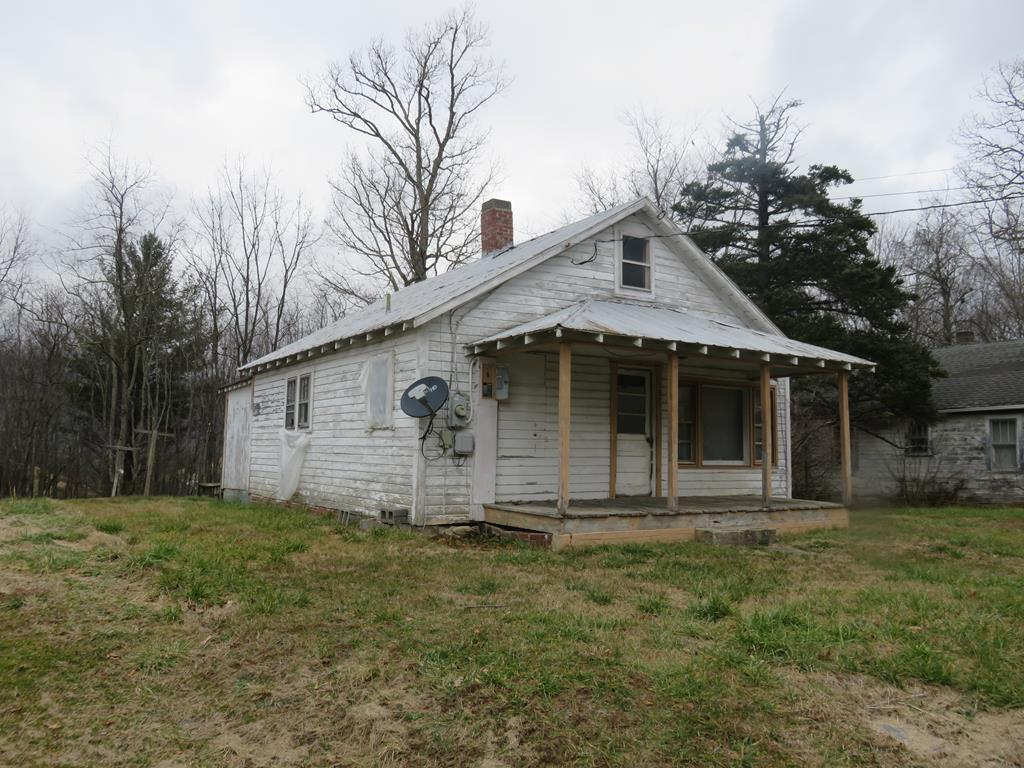 Investment opportunity in the Town of Independence! 2 bed/1 bath fixer-upper has public utilities. Home features one level living with a covered front porch, back deck and flat back yard on a dead end street. Close to town on a secluded street, this home would make a great rental with a bit of work.