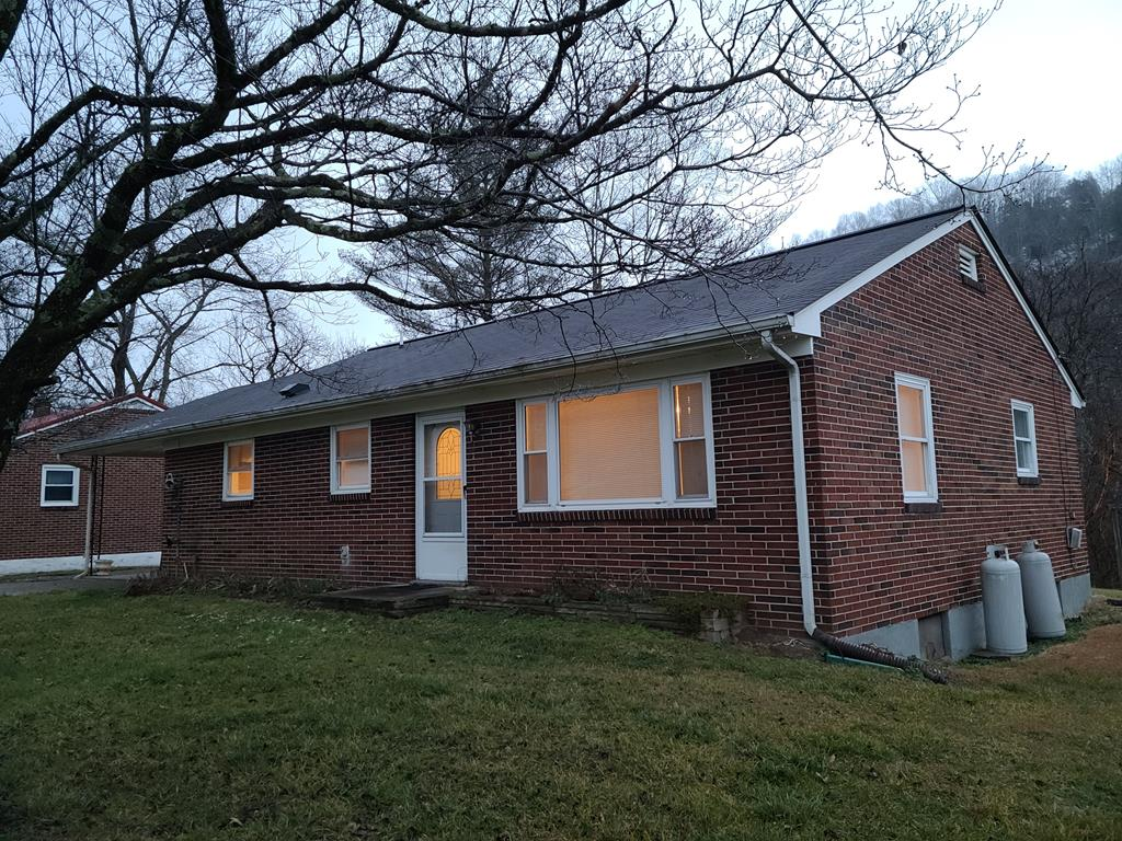 Nice 3 bedroom 1 bath brick ranch that is move in ready!  This home has beautiful hardwood floors throughout, replacement windows, updated kitchen and bath, newer heat pump, a nice gas log fireplace and a basement that could easily be finished for more living space.  Come to Saltville and enjoy the history and quaint home town feeling!