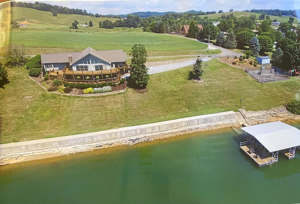 This beautiful home has the best views on SOUTH HOLSTON LAKE, and is ready for a new owner.  There is a fully wired mechanical boat dock, basketball court and storage building on the property.  The home has decking across the front both on main and lower level with views of the mountains and lake.  This home is on a PRIVATE 2 ACRE+ LOT, has beautiful HARDWOOD FLOORING, custom kitchen cabinets, stainless appliances including a sub-zero refrigerator.  High ceilings, porcelain tile, lots of walk in closet space and downstairs there is a stone fireplace in the large den that also has a  wet bar and workout room.  Its hard to find lake property so do not wait schedule now to view this beautiful home.