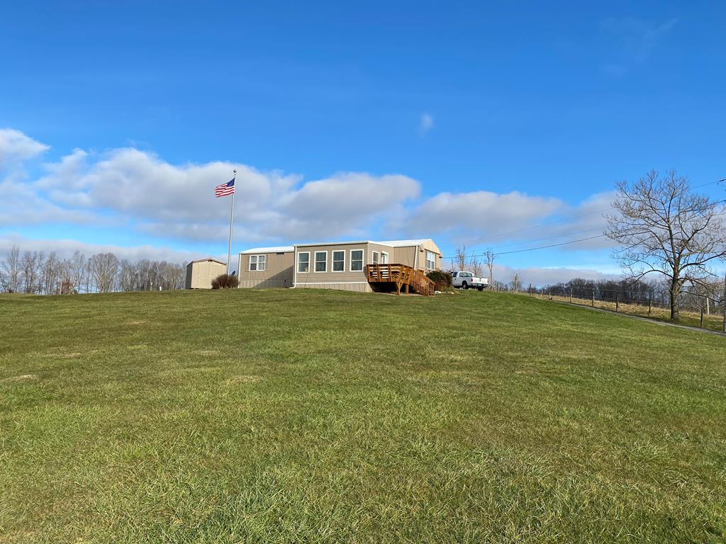 Listed at appraised value! Two bed, One and a half bath home on Three acres with spectacular views. An addition was added onto the home in 2018 providing extra space with a great view of the Holston mountain. The heat pump was installed in 2015, and quarts countertops installed in 2018. The property also features a detached 24'x32' Two car garage. This property is conveniently located just outside of the town of Damascus and is just minutes away from the Virginia Creeper Trail and the Appalachian Trail.