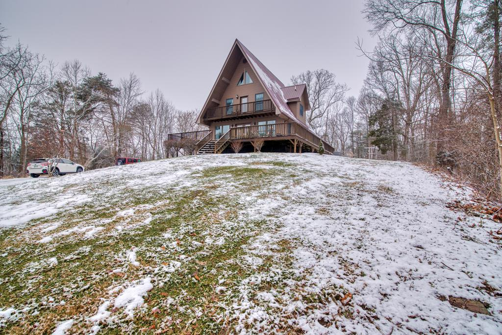 Here is your own little piece of paradise, that you have been waiting for. This gorgeous contemporary A-frame is resting on a pedestal and a one of a kind with majestic views that one can only imagine and just a hop, skip from the famous creeper & AT trail. This 3 bed, 2 bath gem is waiting on you. Upon entering from the open deck you will find trhe inviting open concept with recently updated, cutting edge, state of the art kitchen is awaiting the chief cook to prepare their next masterpiece. Here you will find many updates to include: new solid surface countertops, refrigerator, stove, dishwasher, and microwave and all completely by the beautiful 3/4 in oak floors being most recenlty refinished  kitchen is adjoining the entering great room splendid for entertaining. Just steps away from the kitchen a spacious bedroom as well as a full bath and laundry room on this wing of the home which will allow for one level living. Moving to the second level here you will find two more choice