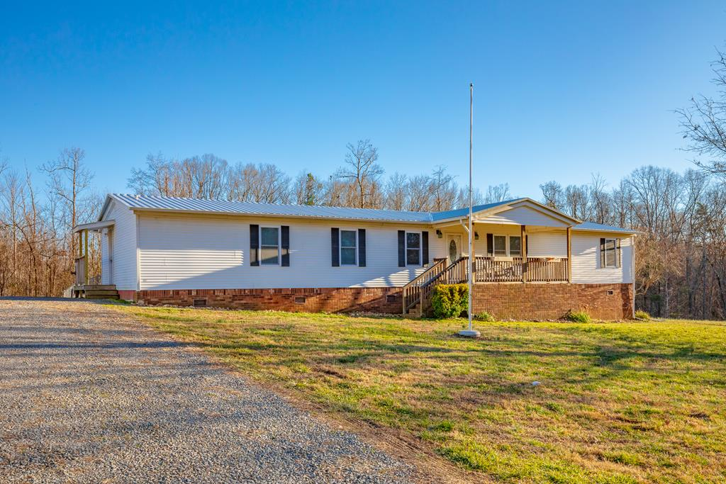 Very nice updated move-in ready home for the entire family with nearly 2.5 acres of flat land. NEW DETACHED 3 BAY 30x40 GARAGE with concrete flooring, 10x10 doors, wood stove included and power to hook up welders and/or compressors. Inside you have newly updated kitchen with soft close cabinets, granite countertops, tile backsplash and new flooring. Eat in kitchen as well as a formal dining area. Newly remodeled master bath with standup shower and walk in master closet, newly updated second bath with full size tub. New flooring in nearly every room. All new insulated windows with single screens. New metal roof in 2018. Cable and high speed internet! Outside a wooden play set with play house and also a patriotic flag pole in front of a covered porch. Under the home your pipes are protected from freezing in the event the weather drops below 39 degrees. (It automatically comes on to heat up the area.) Out back there is a chain link fence with gate to keep your animals in and covered patio
