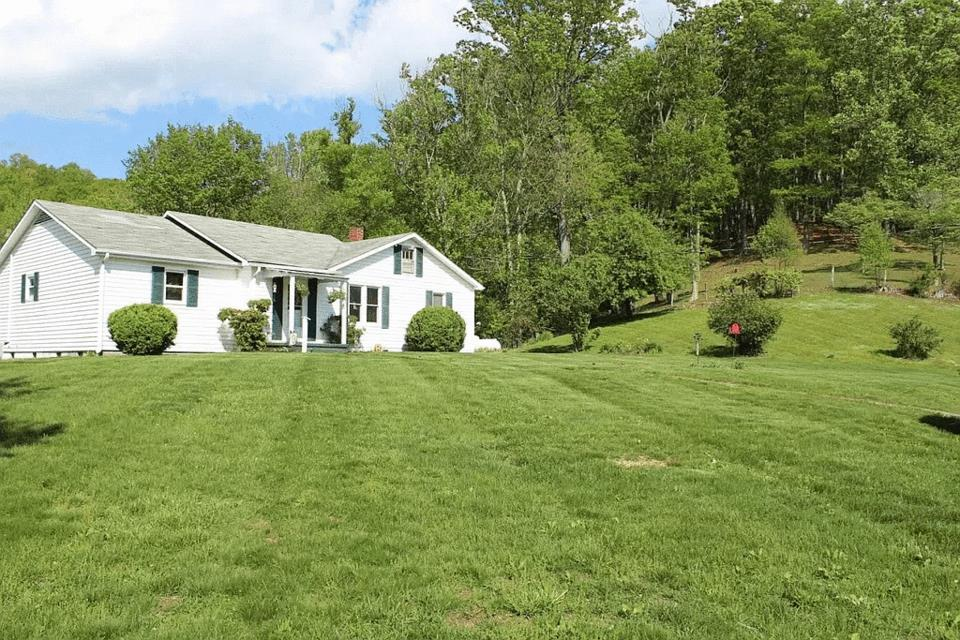 COUNTRY LIVING AT IT'S BEST! Recently remodeled  4 bedroom 1.5 bath Ranch home in Grayson County with great views and a creek on 1.8 acres! Spacious home and  beautiful flooring throughout. Located in a private setting with enough room for a few animals and garden area, 2 outbuildings and within minutes of the Jefferson National Forest and the New River.