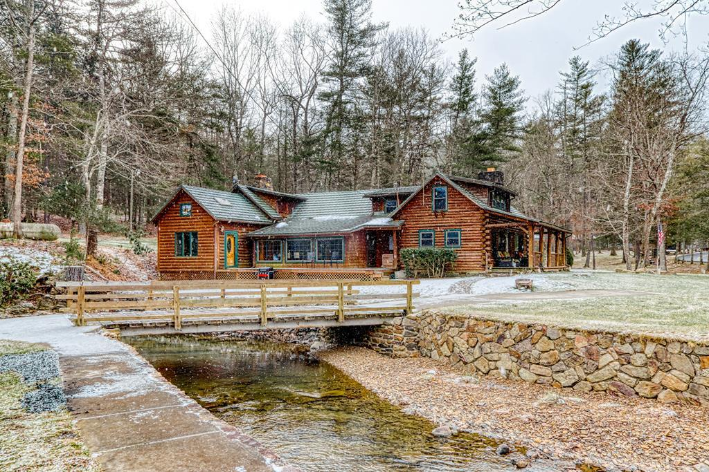 Beautiful mountain lodge joining the national forest with 3 bed rooms and 3 Baths.  Over 3500 feet of living space in this picturesque setting is now being offered.  This custom home offers vaulted ceilings, huge fire place, beautiful hardwood floors and ample space for entertaining and beautiful updated kitchen.  This property is surrounded by beautiful bold Little Creek.  Property has strong Airbnb rental history.  One of Bland County's most unique properties.  Guest cottage is 600 sq. ft full kitchen and bath next to bold stream. Call to schedule an appointment. Flood insurance required if financing.