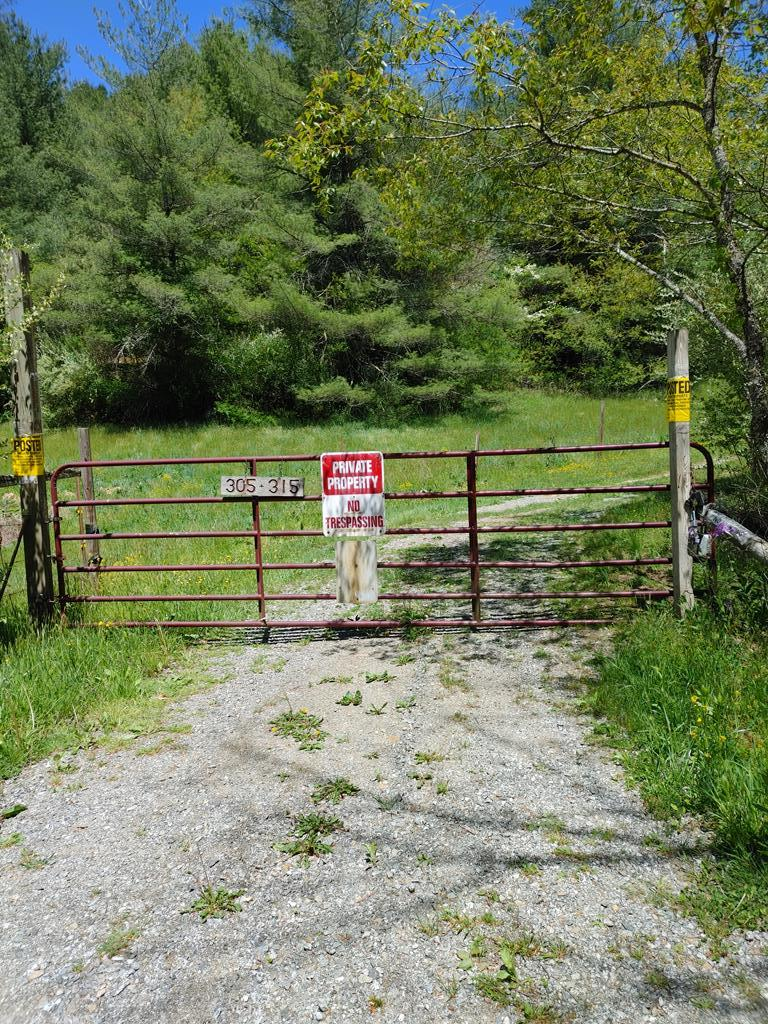 A hunters paradise and a nature lovers heaven sitting on 124 acres with a hunting cabin. Deer stands already in place. Deer, bear and turkeys all over. Wide bubbling creeks all over with small waterfalls that will put you in your own place of bliss (see video). Also has a pond that can be used for fishing (per seller). Venture to the top of the mountain for complete seclusion where the cabin is located. Has roads throughout to enjoy riding your ATV's. Would be a great weekend getaway property. Cabin has electric and has spring water and has a wood stove that will convey for heat. Cabin comes completely furnished, and has a side building set up for a washer and dryer. Cabin is one room with one bathroom. Size of cabin is approx. 425 sq ft. Lots of timber on this property and can be timbered if you so desire. Four-wheel drive is recommended. Property is close to 58 and the NEW RIVER. Property is really a must see with no restrictions and is priced below tax assessment.