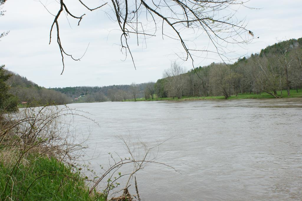 Buildable property on the New River with long river frontage.  Property is elevated on the upper side of the road with multiple building sites overlooking the New.  Recreational opportunities abound.  Come build your home here and have an amazing view!  Conveniently located near Galax and Fries, VA for shopping.  Give us a call today to take a look.
