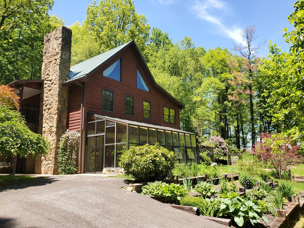 Privacy and Peace of Mind brings you to this mountain home situated on an acre of manicured land.  This property is tucked away on a short dead end road with garden areas, mature trees, unrestricted, but yet so convenient to I-77 at Fancy Gap, Va.  This home has multiple living/entertaining spaces, from sunrooms, greatrooms to a solarium and outdoor patios. Three bedrooms and 3 baths with many upgrades from Granite, slate, real masonry rocked fireplace, tiled showers and more.  This property has a NEW SEPTIC SYSTEM, a generator, outbuildings, firepit and more!  The setting is fantastic !