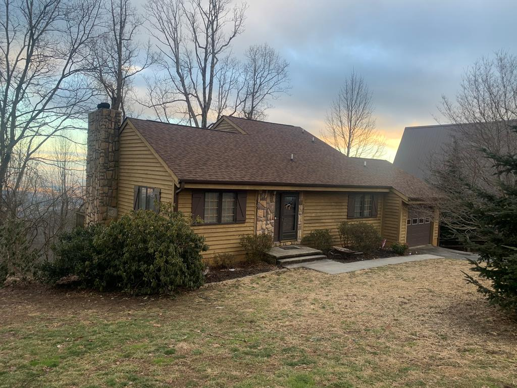 Check this one out! Beautiful 3 bed 2 bath home in Cascade Mountain with beautiful, long-range views from all three decks! This home features a newer HVAC system, furnace, and roof installed in 2016-2017, attached garage, cathedral ceilings, hardwood flooring, floor-to-ceiling stone fireplace, mostly finished basement, and much more! Inside Cascade Mountain, you will find tennis, a swimming pool and clubhouse, a playground, trails, and cascading waterfalls and streams!