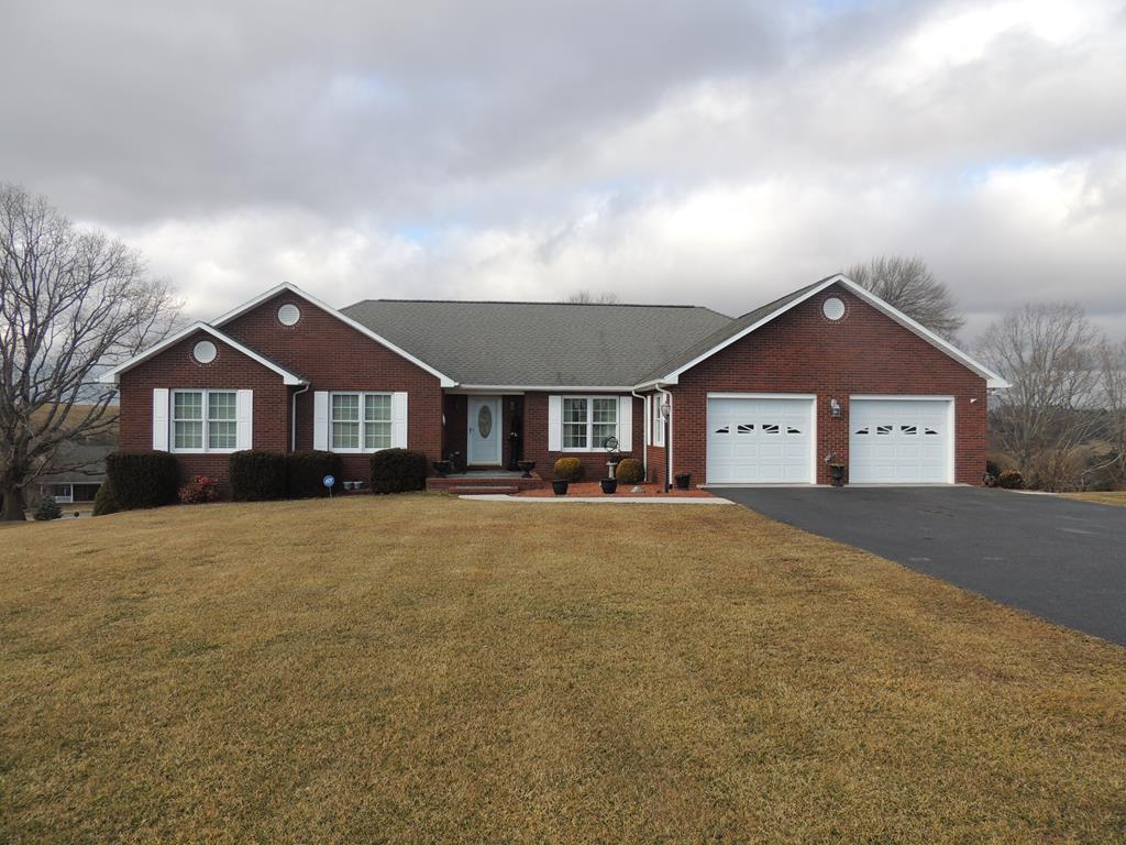 THIS GORGEOUS AND IMMACULATE HOME IS CENTRALLY LOCATED BETWEEN GALAX AND HILLSVILLE IN COMMONWEALTH SUBDIVISION. THIS QUALITY BUILT HOME OFFERS 3 BEDROOMS, 3.5 BATHS, SPACIOUS KITCHEN WITH EAT IN AREA, SEPARATE DINING ROOM, LIVING ROOM, AN ENCLOSED PORCH AREA AS WELL AS A COVERED PATIO WHICH IS PERFECT FOR ENTERTAINING. YOU WILL LOVE THE BEAUTIFUL HARDWOOD FLOORING, 2 CAR GARAGE, PAVED DRIVEWAY AND A HUGE ATTIC WITH STEPS LEADING FROM THE GARAGE  WHICH GIVES LOTS OF ROOM FOR STORAGE. THERE IS ALSO A FULL BASEMENT WHICH HAS A FULL BATH AND IS CURRENTLY BEING USED AS AN OPEN FAMILY ROOM BUT COULD BE CONVERTED TO MORE BEDROOMS IF DESIRED,THE BASEMENT HAS AN INDOOR ENTRY AND A WALKOUT, OUTDOOR ENTRY. THE OWNER HAS SEPARATED OFF A FEW AREAS FOR STORAGE. THE KITCHEN HAS MANY BEAUTIFUL, QUALITY MADE CABINETS, A COOK TOP RANGE, DOUBLE OVENS, A EAT IN BREAKFAST ROOM LEADING TO THE COVERED PATIO.THE BATH IN THE MASTER SUITE OFFERS A JETTED TUB, SEPARATE SHOWER.