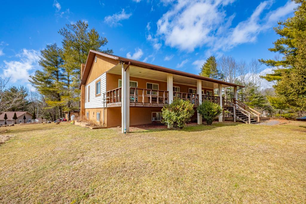 This secluded home has a beautiful nice size, level yard with plenty of room for a garden. On the front is a VERY large covered porch for you to enjoy the quiet and the wildlife.  Inside you'll find a living room with nice size fire place, dining room and large kitchen with oak cabinets that will give you plenty of storage and a nice window over the sink. On the other side of the home you'll find a huge master bedroom and master bath on the main level. On the basement level you have two rooms (one does not have heat), full bath and a family room with wood stove.  The two car attached garage is a very nice size with actual room for your cars as well as the laundry.  With some TLC this could be your perfect second home for large families or full time home. Neighboring 3 bed/2 bath cabin also available for purchase.