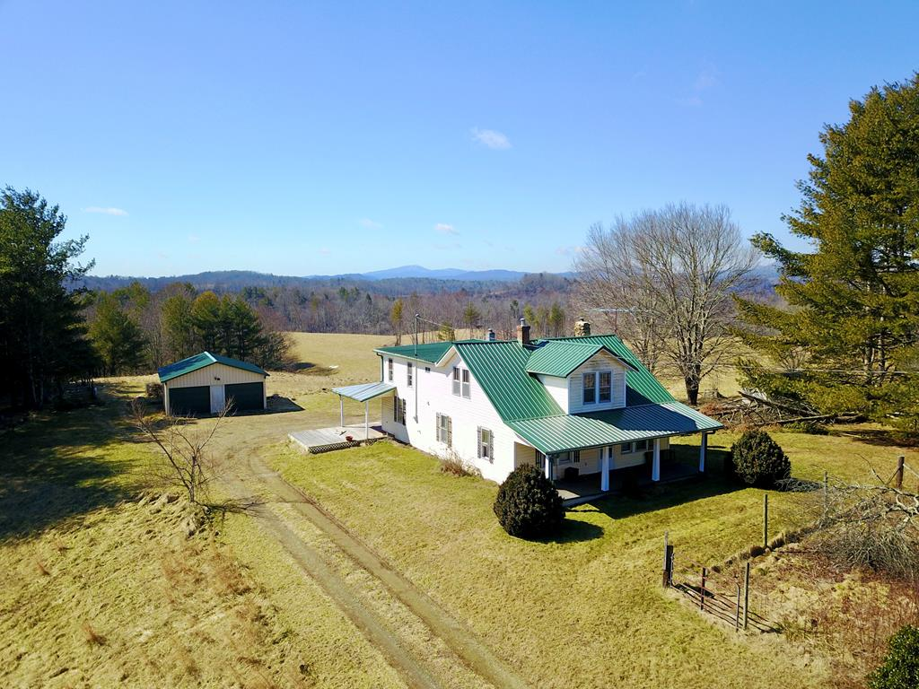 Fixer upper house sitting on 87.739 +/- private acres located minutes from Galax that features open pasture, two small small creeks, spectacular mountain views, multiple building sites, and a two car metal garage. This property could be used as a full time residence, a vacation home/weekend retreat, hunting, farming, or just a great investment! Property like this is close to town is getting harder and harder to find! Don't let this slip through your hands before you look at it!