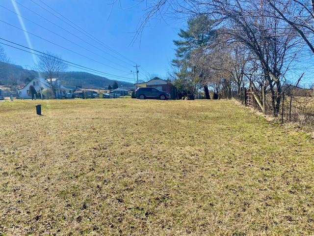 0.89 cleared acres with well (county water is also available) and septic and 3 bedroom/1 bath Singlewide encased in brick for sale!! Investors or future Chip and Joanna's welcome. There is an incredible Mountain View off the back of this property. Convenient location and accessible from Route 100 or exit 24 off I-77. Seller states that tree in the driveway is chestnut and there is a grapevine on current fence line. Property goes further back than fencing, so someone could fence the back side off and have animals with pasture area.  Singlewide needs TLC and a new roof, or could be torn down and something else built in its place.  Property line has all been recently surveyed (survey in photos). Home is being sold as-is and seller will not pay for any inspections or repairs. Buyer to determine internet availability