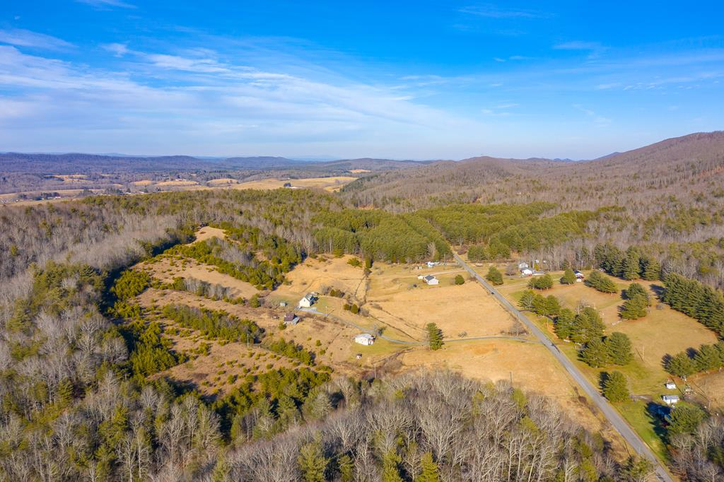 If you are looking for a beautiful property with a mountain view to build your home or for hunting, this is for you. 2 parcels totaling 53.97 acres with paved road frontage in a county setting and only minutes away from town or the interstate.