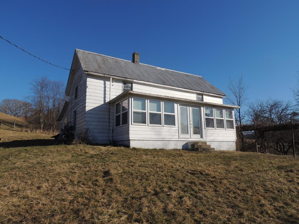 Great first or second home. This home was built in the 1900's and has had some updates. It is in need of some TLC. The owner has incorporated an enclosed front porch with plenty of windows to maximize the true feeling of a farm house. Offering 1 bedroom on the main level and two on the second level with one bath. Plenty room to add on with over 5 acres of rolling, mostly open land. Bring the horses. Near horse trails and Jefferson National Forest. Perfect for investment or rental. A two car cinderblock 24 X 24 detached garage is fantastic for storage or to be used as a workshop. The possibilities for this property are endless. Joining a state maintained road and located near the Elk Creek Valley in Comers Rock, one of the areas most desired locations, this is a must see!! Priced at only $129,900