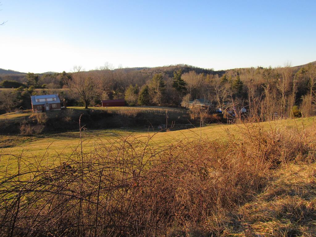Endless possibilities with this farm land, with amazing country views, nestled in beautiful Carroll County. This property provides rolling pasture acreage with flowing springs running all over the property. Completely fenced with a barn on the Orange Drive side. This property has a shared driveway, but there is road frontage on both Orange Dr. and Mill Manor Rd so a buyer could install a private drive almost anywhere. This would be a great homesite, farm, or just a great recreational get away. Land is almost completely open, with very few trees on the lower side. There is natural springs all over, so chose a great place to build a pond, and create your own oasis. The property is surveyed.