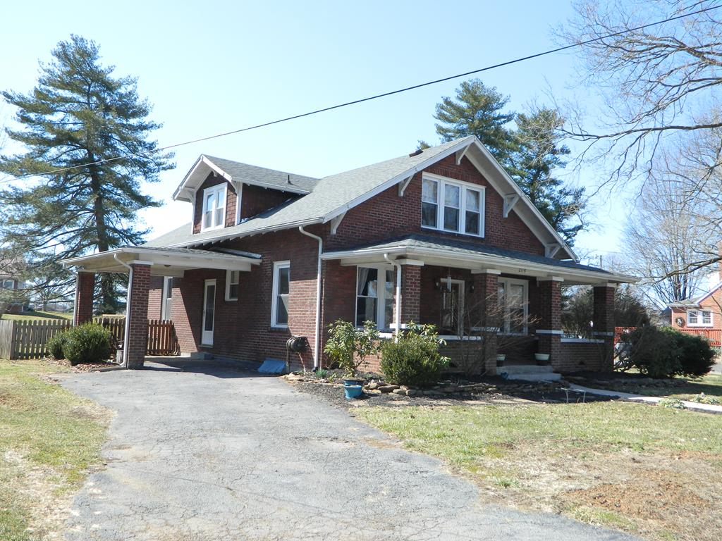 Charm & Character exude from this beautiful brick 3-4 BR, 2.5 BA home featuring a flowing layout of the kitchen, dining & living rooms where you will want to spend your leisure time. Kitchen has large island with granite top & sitting area. Home boasts hardwood & tile floors throughout, beautiful updates including wood & metal ceilings, wood-paneled walls & crown molding. Three updated baths with soaking tub and tile/stone shower & heated floor. Thermopane windows and warm, gas hydronic heat. Roof new in 2012 - 30 year architectural shingles. New electric water heater. Den has gas logs fireplace, living room has wood burning fireplace. Office/den & attic storage on second level. Step out onto front covered brick/tile porch out of living room to relax. Spacious & private, the covered porch & deck off kitchen is a favorite gathering spot. Fenced backyard includes firepit, jungle gym & storage building..(Trampoline is negotiable). Covered patio. Close to downtown amenities & eateries.