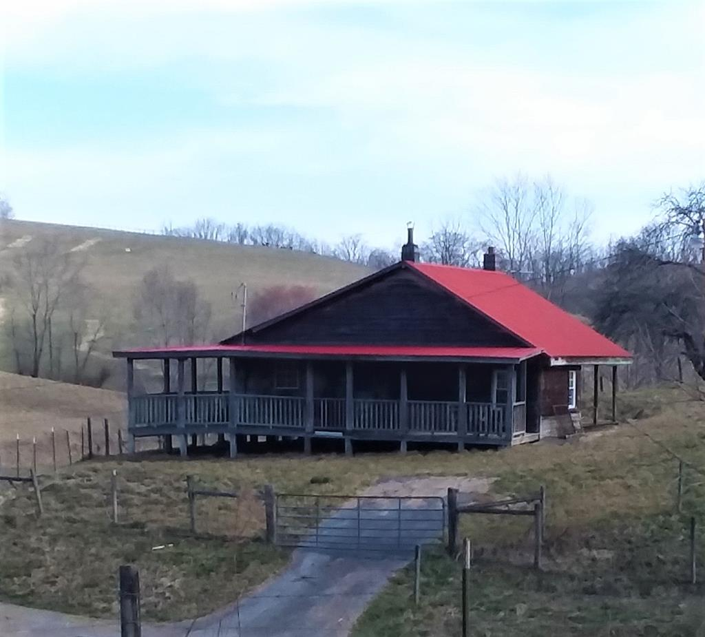 A 2 BR, 1 BA cabin comes with this 38.68 acre farm nestled in the Appalachian Mountains yet minutes to U.S. Hwy.11 and Interstate 81. Cabin has hickory kitchen cabinets, tile in kitchen and bath, covered front & back porches with open deck. Includes barn, covered feed lot, storage shed, spring house & cabin. Artisan well and pond on property. Great mountain weekend getaway! Cabin needs water & electricity connected, and septic installed. Pond needs work - cattle busted drain pipe. Good fencing for livestock. Neighbor has been running cattle on property. Great building sites. Zoned for manufactured or mobile homes too. Timber has not been cruised. No phone or internet established there.