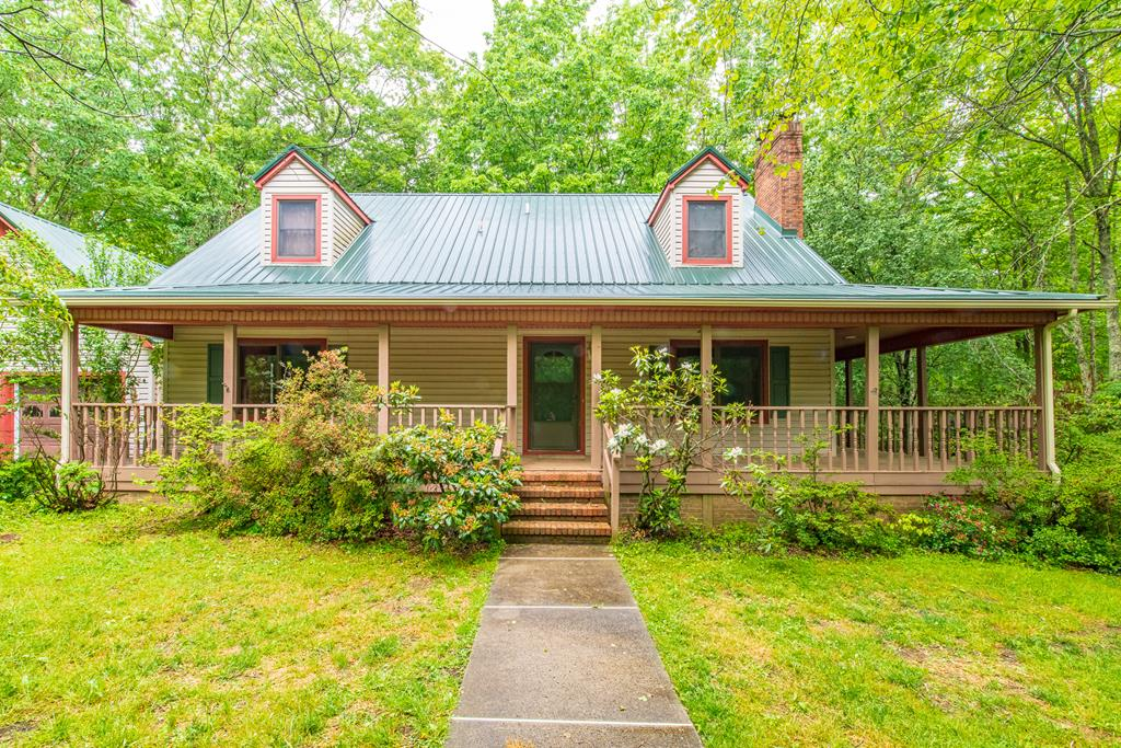 Beautiful cape cod home nestled on about 7 acres of wooded land. You are 4 minutes to the Old Mill Golf Course, and are less than a mile from the Blue Ridge Parkway. This charming home has a great floor plan, and tons of space with 3324 SQFT. You will love the piece and quiet as you enjoy the wrap around porch. The kitchen is huge, and offers plenty of counter space, as well as storage and a pantry. The living room has a gas fireplace, and the master bedroom is on the main level. The basement offers a separate living space for an in-law suite if desired. You have a small kitchenette that leads into the entertaining area. The attached 2 car garage is spacious, and has enough room for your vehicles, as well as storage/workshop area. You have central heat and air throughout the main and upper level. The upstairs has an abundant amount of storage, and 2 bedrooms. One could easily be used as an office. You also have DSL high speed internet at the home, so you can work from home. Call today!