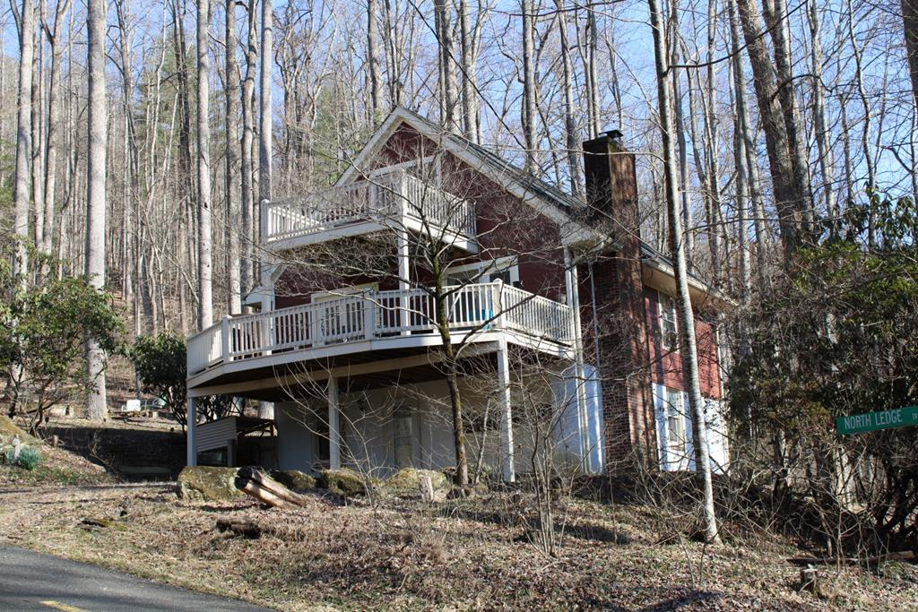 Private cabin in Cascade Mountain Resort, a gated community. This home offers 1742 sq. ft., 4 bedrooms and 2.5 bathrooms. On the main level you have an open dining and living room with a wood stove that goes out to the open deck, a kitchen, one bedroom and a full bathroom. Upstairs you have two spacious bedrooms, one has an open deck and one has a half bathroom. In the basement you have a den with a wood stove, laundry room, full bathroom and another bedroom. Home comes partially furnished. Wood stove is included. Newer roof, siding and deck. Land features: Corner lot with large outcropping rocks. Large 12' x 24' patio with a fire pit to sit and enjoy mountain living. Very private with 2 lots.