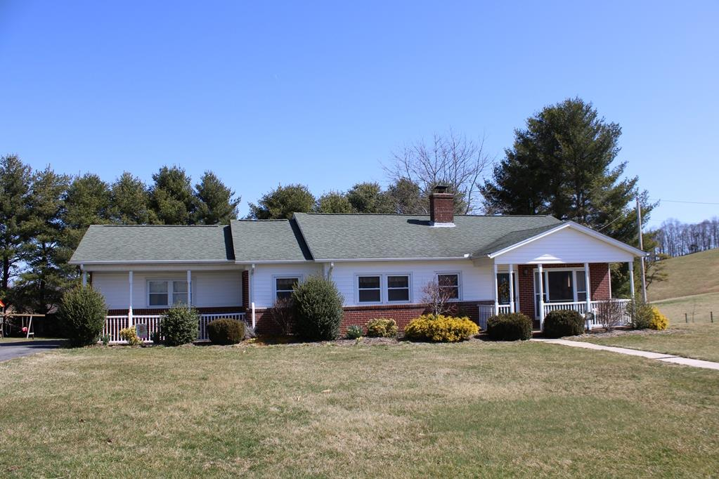 Exceptional home located between Hillsville and Fancy Gap. Home features: 2604 sq. ft., 3 BR, 2 BA, Finished basement, Beautiful hardwood floors & tile throughout home. On the main level you have a living room with countryside views, kitchen with custom oak cabinets & corian counter tops, master bedroom has a walk in closet and sliding doors going out to the 10' x 25' back open deck, master bath, 2 more spacious bedrooms, bath and laundry room. On the lower level you have a large family room with a wood burning stove, an oil monitor, lot of storage cabinets, 2 additional rooms for an office or bedroom and a storage area. Land features: 1 level to rolling acre, 12' x 18' garage with a lean to that has power, paved driveway and home is on a private corner lot. Out back you have a cascading waterfalls, coy pond and a  stamped concrete pad leading into the walk out basement. Nice landscaping.