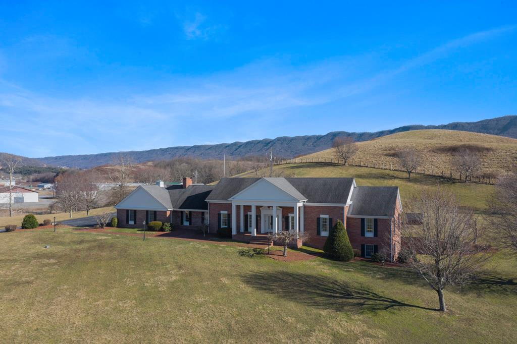 Located in Tazewell County,VA, bordering the Clinch River, Hwy 460, within close proximity to the Back of the Dragon and 15-20min to Bluefield, WV, this established farm is truly a rare gem! Here is your chance to own 3 properties in one! Live in the main house and let the others help offset your mortgage payment! The manor house offers one level living, with 3 bedrooms and 3 full bathrooms, a large eat-in kitchen, separate dining room, living room, office/den on the main floor and a 4th full bath, several utility or storage rooms, laundry and great room in the basement. Outside, find a wonderful open patio for entertaining, gorgeous property views and an oversized 2 car attached garage. The first additional property is a well kept 1972 doublewide, with 3 bedrooms & 2 baths. The second property is a 3 bedroom 1 bath ranch style home, with a 3 bay drive under garage & overlooks a 1.6 acre pond.