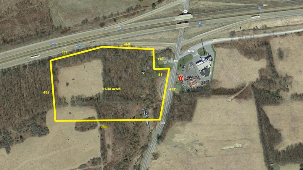 Gently rolling hills on this property located right off of the interstate at exit 60. Over 11 acres total with 50% cleared. Perfect location for commercial use. Restrictions listed on deed.