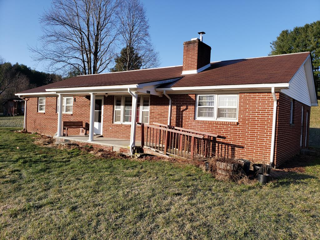 Mountain Home with Views and a Creek. This 4 bedroom 1 bath home has beautiful views of the surrounding countryside, it is a picturesque, quiet community. The home is solid with a new roof and some recent upgrades. There is a full unfinished basement and several outbuildings including a detached garage. The yard is large and mostly level with lots of fruit trees and bushes, there is a perfect area for a garden. There are 2 nice branches on this property as well. This property is located in close proximity to Jefferson National Forest and not far from Grayson Highlands Park and the New River.