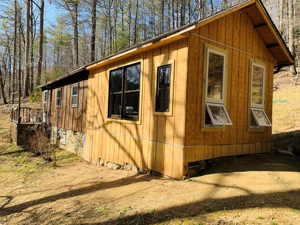 """Check this one out! Nice, secluded recreational property fronting on Elk Creek, a stocked trout stream. This property features a nice """"cabin"""" with a newer septic tank, a nice spring, a creek, plenty of woods with lots of wildlife, and a nice area with a deck for the family to park the camper!"""