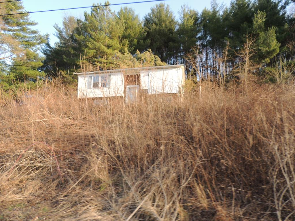 16 lots totaling 1.7 acres of land located on the desirable Whispering Pines Subdivision. You could possibly have two building lots or one building lot with a large yard. Property has a home on site that is unsafe and uninhabitable. Do not enter home. Do a drive by today!!