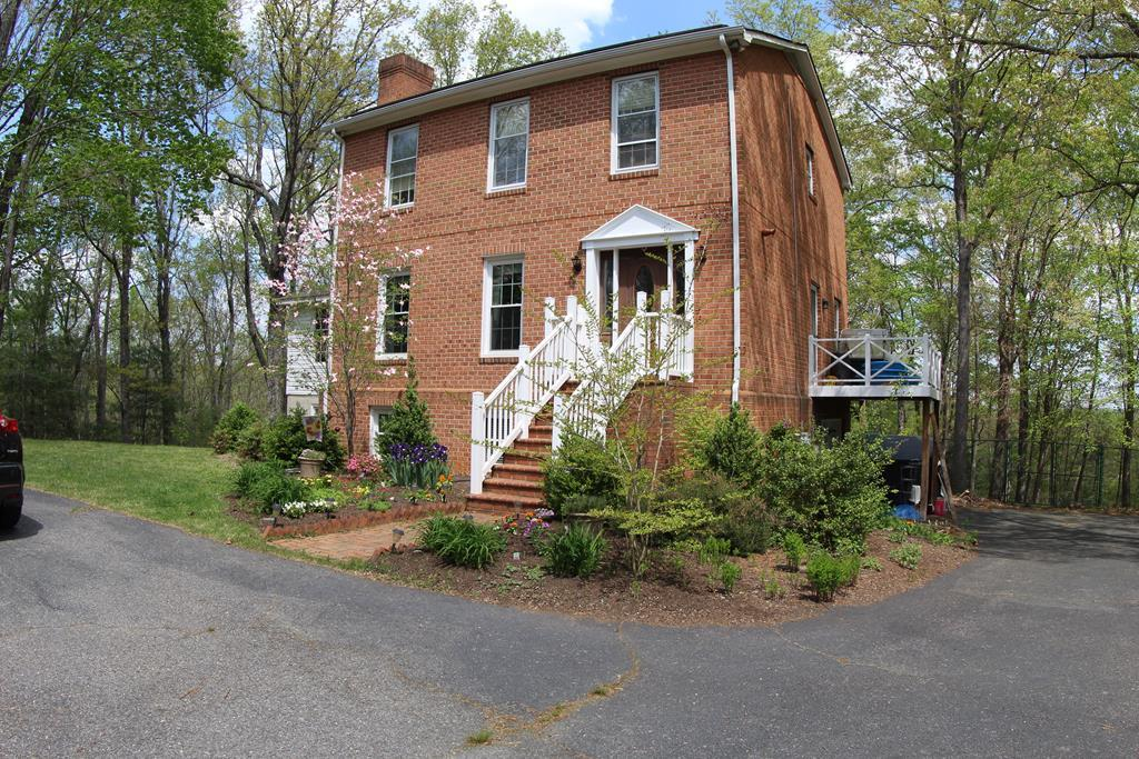 """2 Story Home in excellent condition with full finished basement located in Patrick County, VA (875 Massey Road, Stuart, VA 24171). Approximately 3,250 sq ft finished. First Floor: Foyer: (13'10"""" x 5') Hardwood Floor. Living Room (13'2"""" x 13'10"""") with gas log fireplace. Reading area/library with built in shelves (10' x 13'6""""). Large Dining Room (19'10"""" x 15'4"""") Hardwood Floor. Kitchen (17'2"""" x 13'4"""") Island In Kitchen. Pantry off Kitchen.Sliding Door to back deck (10' x 20') from Kitchen. Laundry in Kitchen (6'4"""" x 3""""). Full Bath (5' x 7.8"""").2nd Floor: Bedroom (15'4"""" x 10') Carpet and Ceiling fan. Owner is using this room as an office at the present time. Full Bath (9'6"""" x 8'4"""") with double sink. Master Bedroom (15'9"""" x 13'3"""") ceiling fan and carpet. Bedroom (11'2"""" x 13'2"""") ceiling fan and carpet. Full Finished Basement: Family Room (12'8"""" x 26'6"""") with wood burning fire place. Bonus Room (12'6"""" x 26'6"""") with Lots of Storage andFrench door to back yard.Music Room (19' 10"""" x 15."""