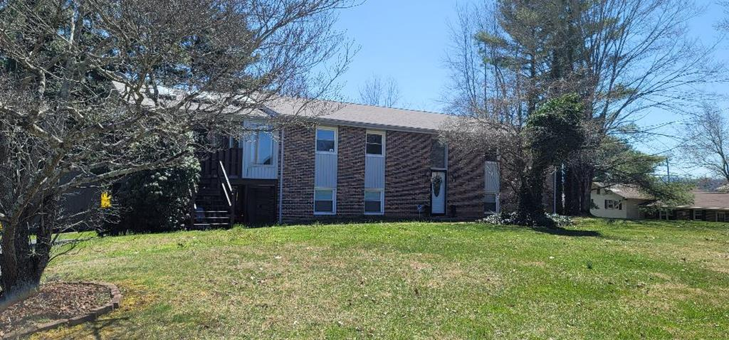 Beautiful remodel in the Hall Addition!  This home is currently being used as a 3 bedroom with a large office.   Newly updated kitchen, baths, roof, 2 heat pumps, water heater, new flooring and a new storage building with a loft.  See list of updates located in the kitchen.  Plenty of outside area for entertaining ~ covered deck, open deck and fenced yard! Basement fireplace has an electric insert should you remove it this could be wood burning.  Fireplace in the kitchen is a gas log.  Fireplace in the living room does not convey.