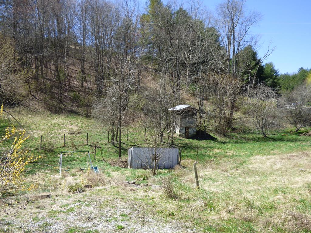 5.46 acres building lot available in this beautiful mountain section of Grayson county. The home that was on the property burned down and as far as the owners know the well and septic are still viable. ( The Buyer and buyers agent to confirm) There are many farm sheds on the property.  A small seasonal stream also flows through the property.  Location is the key to this property.  Come see for yourself and build your dream home.  The property is being sold as-is and the buyer will have to clear home wreckage.