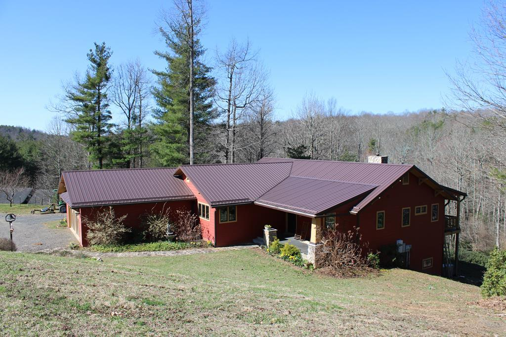 Exceptional Custom Built Home with 6.7 acres adjoining Crooked Creek for approximately 600 feet. Home features: Hardi Plank siding, metal roof, 2 car garage with a utility sink, 2243 sq. ft., 3 bedrooms, 2.5 baths, custom red oak trim and doors throughout, large open floor plan with a gas log fireplace and double doors going out to the 10' x 48' covered deck, the kitchen has granite counter tops and custom cabinets, master bedroom with double doors out to the hot tub and a walk in closet, master bath with double sinks, granite counter tops and a tiled shower, you also have another bedroom, bathroom and a large laundry room. On the lower level you have a bedroom with a half bath and 1131 sq. ft of unfinished  area with a wood stove and shelving. Home also has a 20kw Generator. Land features: 6.7 acres bordering Crooked Creek, 18' x 24' Detached garage with a bathroom, overhead storage with it's own septic and shares the well with the house. Apple and peach trees.