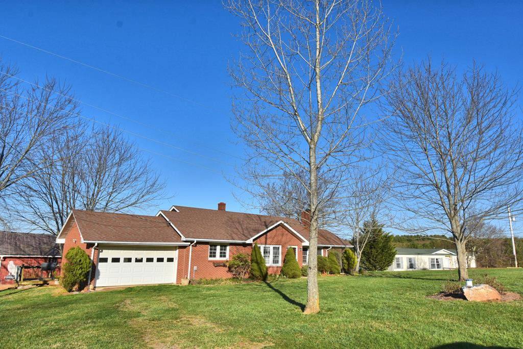 Sweet farm property with two homes and 28.8 beautiful acres just off the Blue Ridge Parkway in the Hillsville area of Carroll County.  First home is a 2-bedroom, 1-bath brick ranch style home with 2 car attached garage, hardwood floors in living room and bedrooms, parquet in dining room, ceramic tile in the kitchen and bath. Fireplace with wood stove insert in the living room. Full unfinished basement offering tons of storage space and a great place to can your garden harvest. With some fresh paint, updates, and your personal touches, this could be a fabulous home. The second home is a well kept 3-bedroom, 2-bath 2008 Clayton doublewide with carpeted and vinyl floors. The acreage is picturesque with garden space, barn, outbuilding, lush green fields, woodlands and gorgeous pastoral and mountain views.  The location is just off the Blue Ridge Parkway. This property is ideal for those looking for farm property, a place for extended family, or investment property.