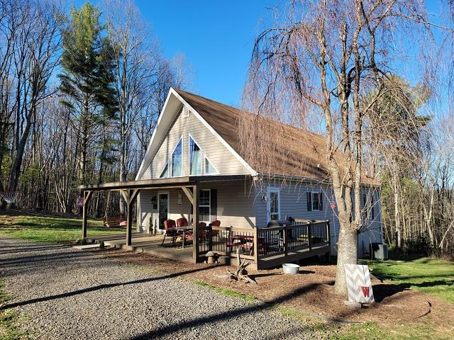 Cape Cod just off the Blue Ridge Parkway with privacy on 4.2 Acres! Spacious 3 bedroom 2 bath home with master bedroom and bath on the main level, laminate flooring, huge bedroom on upper level with sitting area, heat pump and full basement!