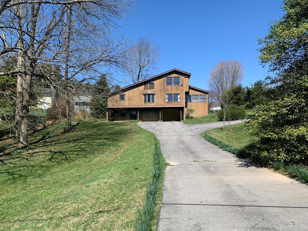 Spacious home on .80 acre lot. Panoramic views, slightly sloping lot with mature landscaping. Convenient to schools, Hungry Mother State Park, Emory and Henry School of Health Science, community pool, and downtown. Two car garage with office area. Large rooms with generous closet and storage space. Eat-in kitchen. Hardwood floors in dining room and hallway. Circle driveway for easy ingress-egress. This home needs a family.