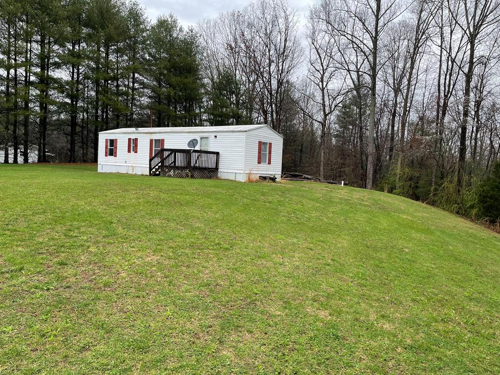 Great Location!!  Quiet rural street with rolling hills just 10 mins from Historical Downtown Mt Airy NC.  Property is 1.18 acres with a 14X50 Manufactured Single wide .  Being sold as is, the interior of the home needs  work but with a little TLC and effort can be made into a nice place to call home.  Has Septic, Well and Electrical already in place!  Buyer to determine internet availability.