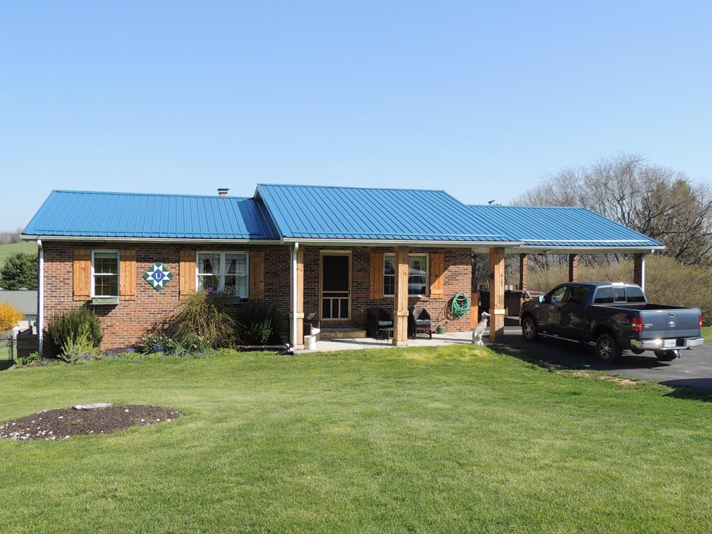 OMG! CHECK OUT THIS 1764 SQ. FT. BRICK RANCH. THERE IS SO MUCH TO SEE HERE...3 BEDROOMS, 2 BATHS, 588 SQ.FT. DEN/FAMILY ROOM IN BASEMENT. HOME HAS THAT RUSTIC FARMHOUSE FEEL. PLENTY OF ROOM TO GROWN WITH AN ADDITIONAL 588 SQ.FT. UNFINSHED BASEMENT WITH GREAT CEILING HEIGHT!  FRESH PAINT, UPDATED FLOORING, ATTACHED 2 CAR CARPORT, FENCED BACKYARD, METAL ROOF, MOUNTAIN VIEWS FROM THE BACKYARD...THE LIST JUST KEEPS GOING. CHECK THIS ONE OUT QUICK!
