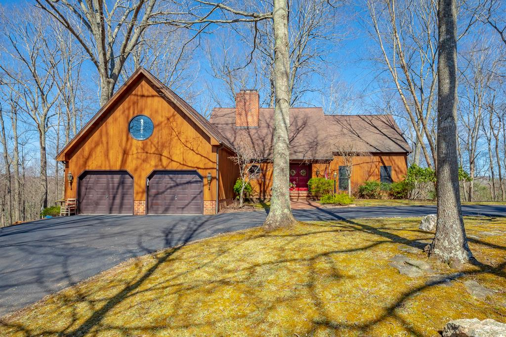 Privacy yet in a neighborhood, in town! Yes! Here you're surrounded by beautiful trees out every large gorgeous window. Pride of ownership shows in all the details of this cedar-sided home. Main level features kitchen, living room or dining room, powder room, master ensuite with balcony and walk in closet, AND laundry room. 2nd floor features a master floor!! You have another living room, another master w/ensuite (double sinks), countless closets & a balcony! Downstairs you have a completely finished basement with YET ANOTHER bedroom with ensuite and a wet bar in living area. This beautiful home also features an office or Mother-In-Law suite above the attached garage w/ensuite that has it's own private entrance.  Above the 2nd story you'll find a loft in case you still need extra space!! No room to talk about all the GORGEOUS kitchen details, custom cherry cab, solid OAK FLRG. Gotta come see to believe this masterpiece.  Outside there is extensive decking all around to entertain.