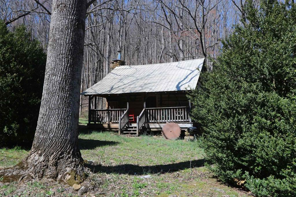 Charming Civil War era cabin with power, water and full bath on +/- 19 acres on a private dead end road. This place has lots of character and privacy but with good access. Enjoy the peace and quite of the mountains in this log cabin home. Come hike the woods and wade the brook.