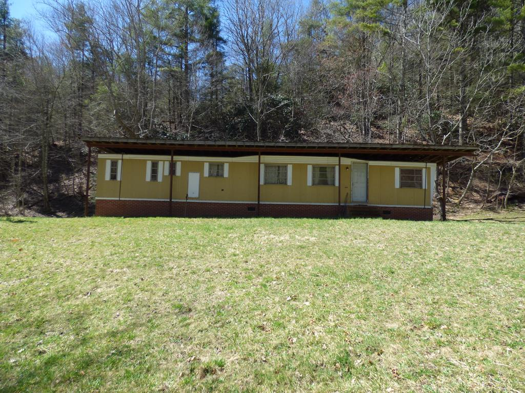 Everyone wants hunting land that joins the national forest.  Here is your chance to own 50 + acres with a single wide that can be used as a hunting lodge. Take your side by side or backpack and enjoy the winding trails back through this pristine tract of land.  Call today this one will be gone.