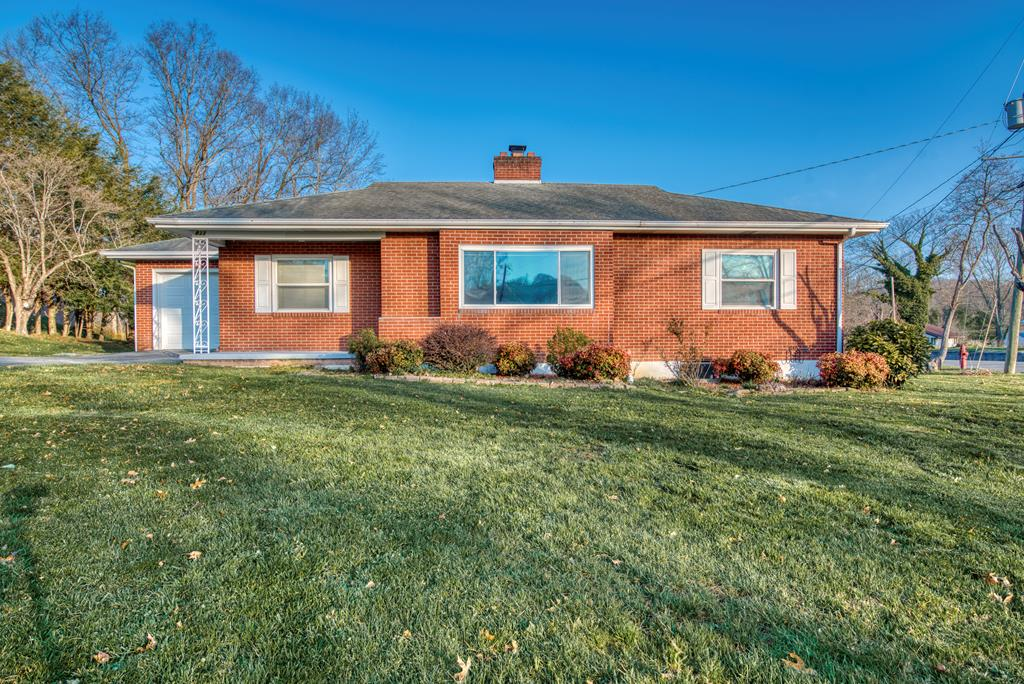 This charming brick home is full of potential and ready for you to make it your own! It features a spacious living room with a beautiful brick fireplace and hardwood floors throughout. The home also offers a full unfinished basement that could easily be finished out for extra finished living space. The property is located on a large corner lot just minutes away from downtown Marion and Interstate 81. Priced to sell!