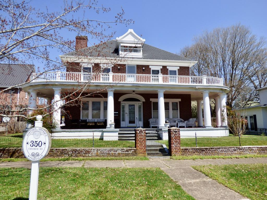 """This beautiful historic home with a spectacular wraparound porch on Church street is truly a gem waiting for its new owner.  Located in the heart of Wytheville on a private lot.  The home features large open rooms, beautiful hardwood floors, an enclosed sun porch in the rear of the home, spacious kitchen.  The rear of the home has a nice level yard with a """"park-like"""" feel and an open deck with a pergola and a spacious detached two-car garage. Lots of privacy but only a block from downtown Wytheville.  This one has to be seen to appreciated.  Call today for a private showing before this one is gone."""