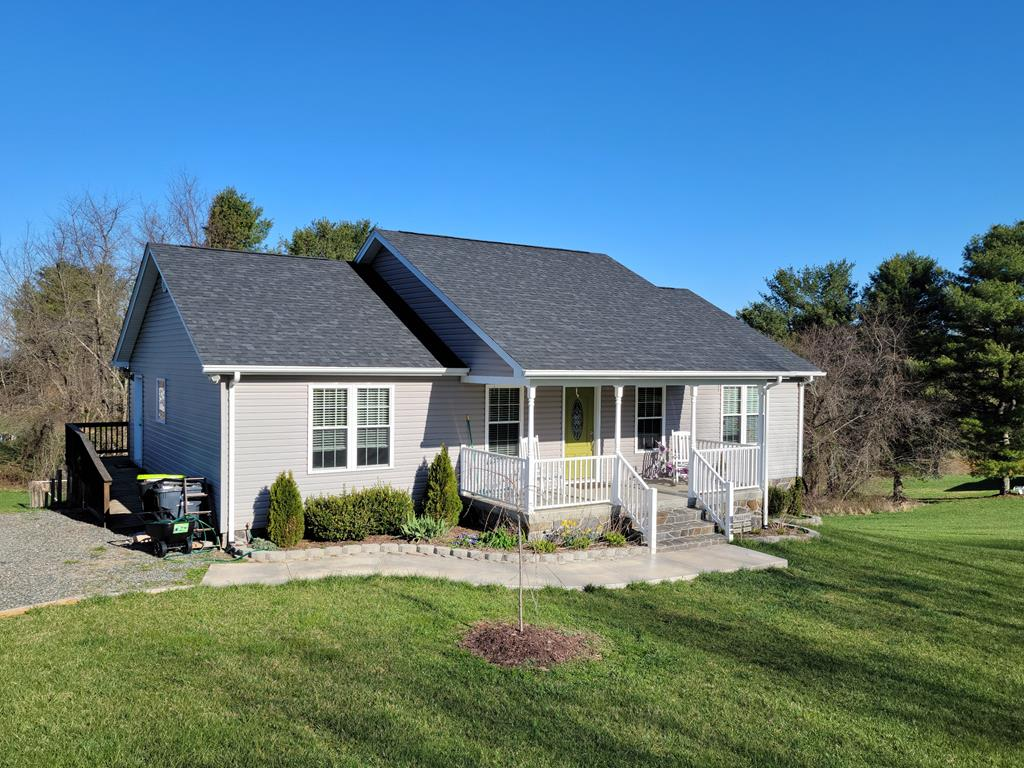 Outstanding 3 bedroom 2 bath home situated on 2 lots and located within minutes to the town of Hillsville. Beautiful home Built in 2015 featuring a open floor plan with hardwood and carpet flooring, Cathedral ceilings, Kitchen with custom cabinets and granite countertops. Large master bedroom with tile shower and walk-in closet. Full basement framed out and ready to finish to your liking. open deck and fenced lot. Covered front porch with long range views.