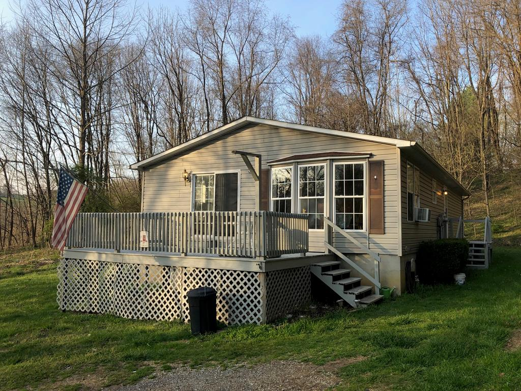 This manufactured home sits on approximately 6.69 acres of land conveniently located near Clear Creek Golf Course, the Exit 7 area, and it's just a hop and skip to Abingdon.  This home offers seclusion, privacy, a creek, and plenty of wildlife!  This 2 bed, 2 bath home has a large kitchen with a ton of countertop space. There are 2 parcels - the possibilities are endless!  INVESTORS take note!  Home is being sold 'AS-IS'... this property is priced to sell so don't delay!