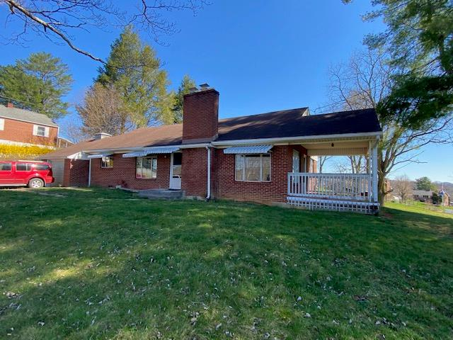 Here is an opportunity for you to turn this House into a Home.  This 3 bedroom brick ranch has been one family built and owned and has the bones for a great restoration.  Inside you have 3 bedrooms, 1.5 bath, dining room, kitchen, large living room, 1 car attached garage and a basement.  Walk from your living room onto the side porch and enjoy a view you only dream of.  Sitting on 2 lots totaling 1.29 acres this is a rare opportunity that comes up.  Home has hardwood floors and a brick fireplace. Call today to view and learn about a renovation loan.